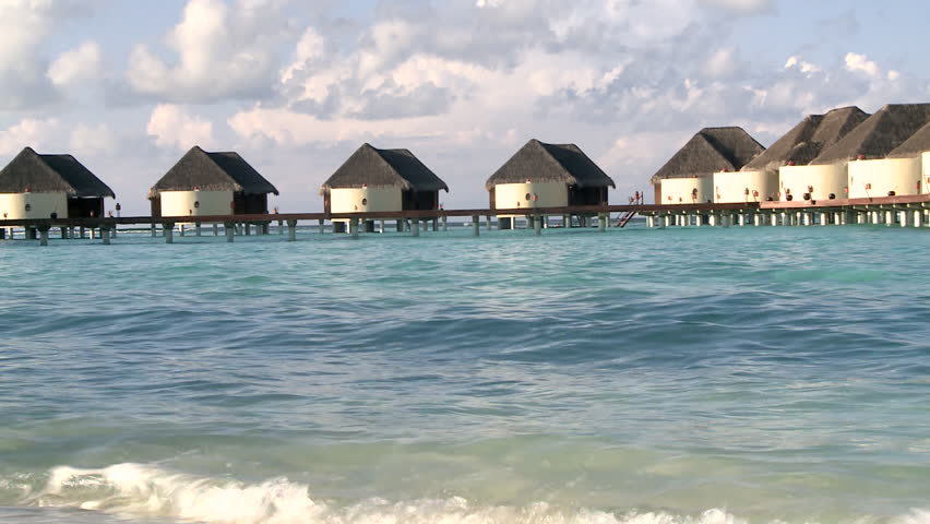 Cottages Above Beach In Maldives