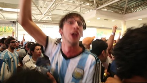 SAO PAULO, BRAZIL - CIRCA JULY: Argentina fans sing and dance before the mach Argentina x Netherlands in 2014 World Cup