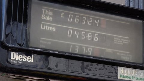Fuel pump showing Pounds sterling and litres going up. UK England Fuel Price Inflation - 02666698