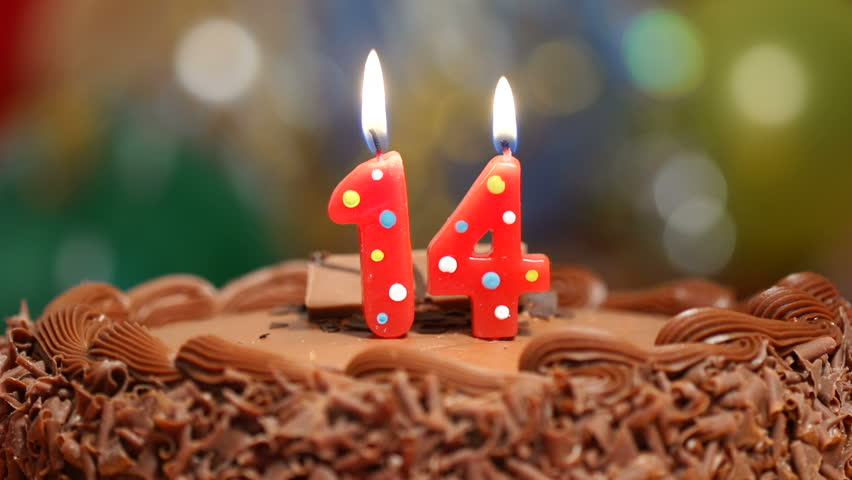 Candles On A Cake Are Blown Out For 14th Birthday