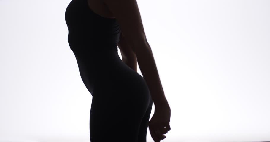 Silhouette of pretty woman dancing in slow motion | Shutterstock HD Video #6858547