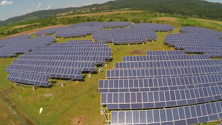 Aerial  view over photovoltaic solar units  producing renewable energy | Shutterstock HD Video #6866977