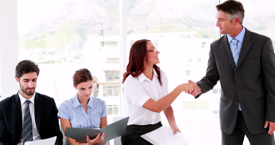 Business people waiting to be called into interview in the office | Shutterstock HD Video #6874612
