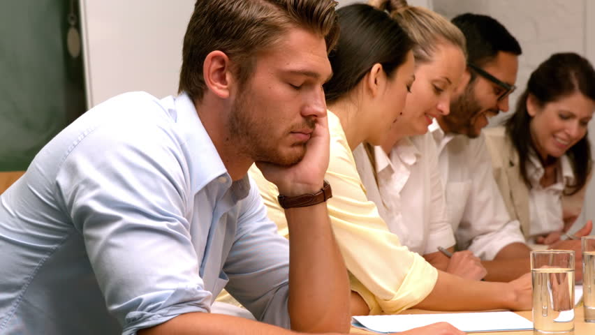 Casual businessman falling asleep during meeting in slow motion #6875617