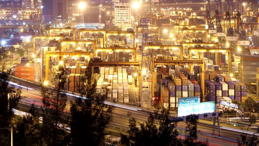 Cargo Container Loading Activity. Timelapse at night. Wide shot. Slowly zooming in. Busy traffice on highway at the front.    | Shutterstock HD Video #690397
