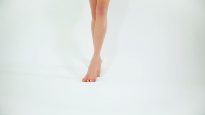 Woman walking barefoot on white studio background | Shutterstock HD Video #6933715
