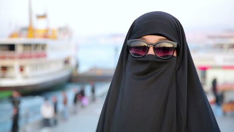 steadicam - Woman with chador, hijab wearing sunglasses