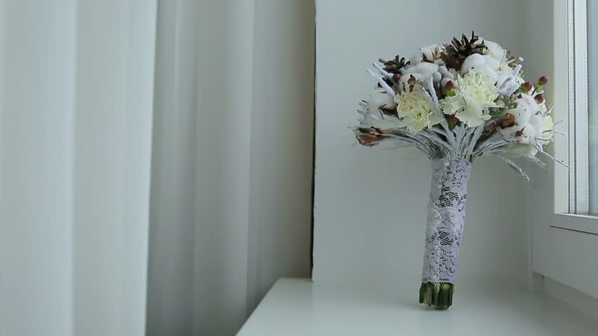 SAMARA, SAMARA REGION/RUSSIA - NOVEMBER 29: Unusual winter bridal bouquet with cones on November 29, 2013 in Samara.    Shutterstock HD Video #6934537