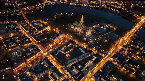 Aerial view over central Trondheim and Nidaorsdomen, in Trondheim Norway, at night.
