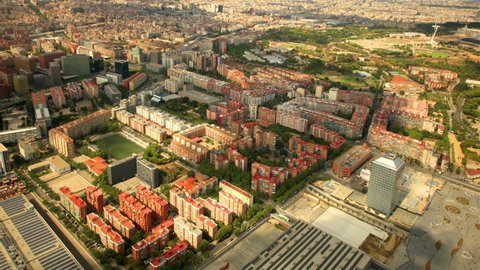BARCELONA, SPAIN, AUGUST 2013 Aerial/Helicopter view over apartment buildings and the Olympic park in the distance.