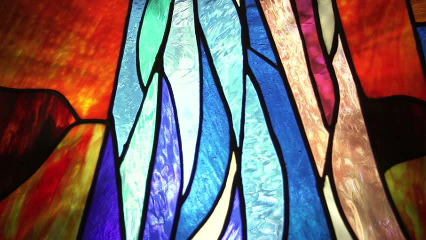 Seamless Loop Background Stained Glass window changing color with a motion glow behind it.