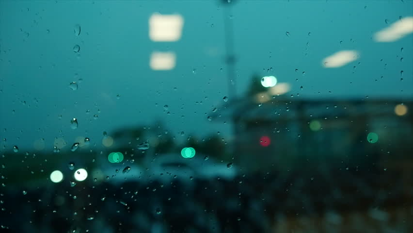 Slow motion of rain drops running down on window. raining day. blurred background | Shutterstock HD Video #6991069