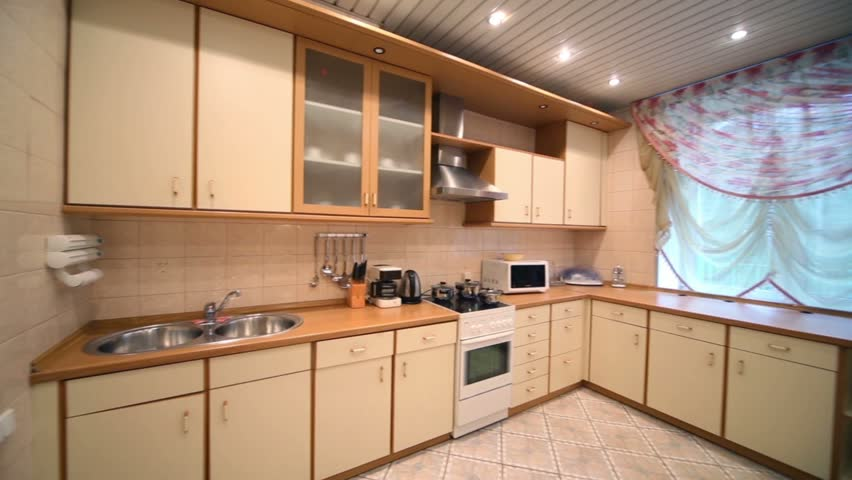 Interior Of Modern Kitchen With Beige Furniture And Stove