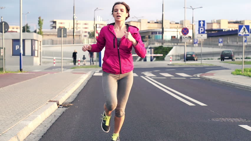 Young woman jogging in the city super slow motion, 240Fps
