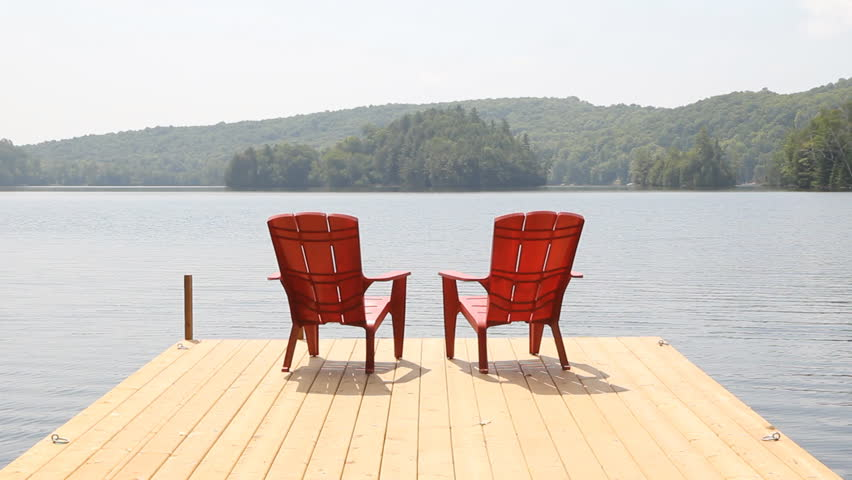 Stock Video Of Two Red Chairs On Cottage Dock 7067317