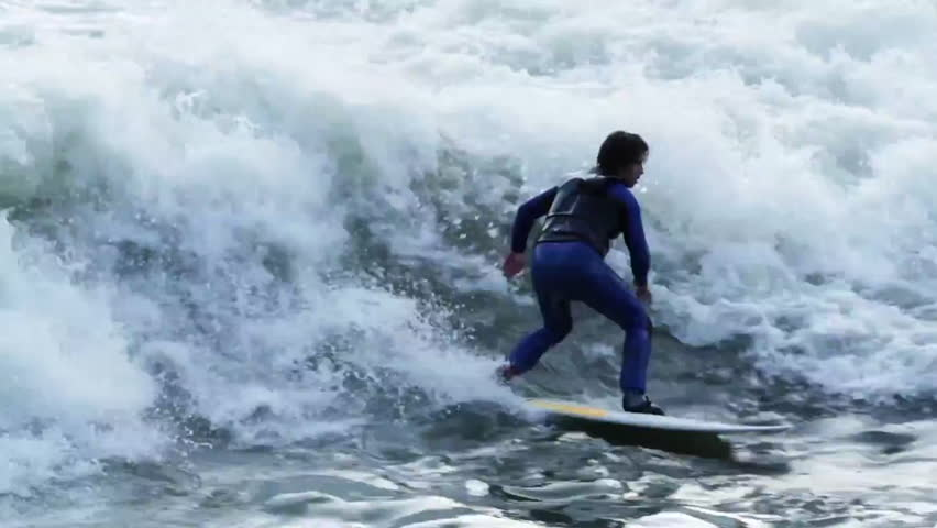 A surfer carves while river surfing in rapids   Shutterstock HD Video #7095118
