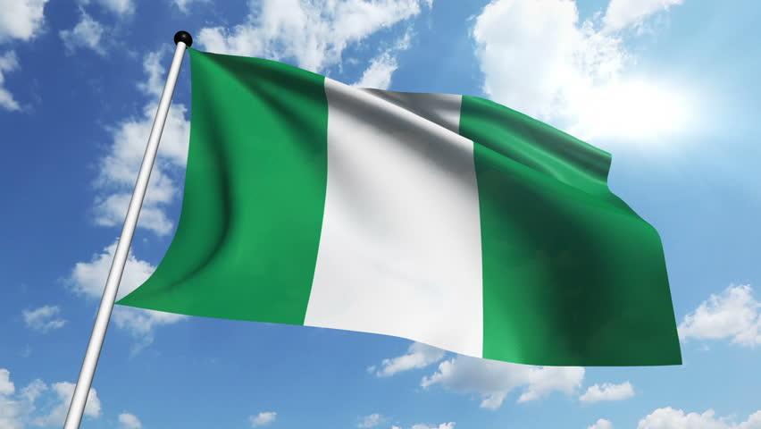 nigeria national flag waving on flagpole on green screen