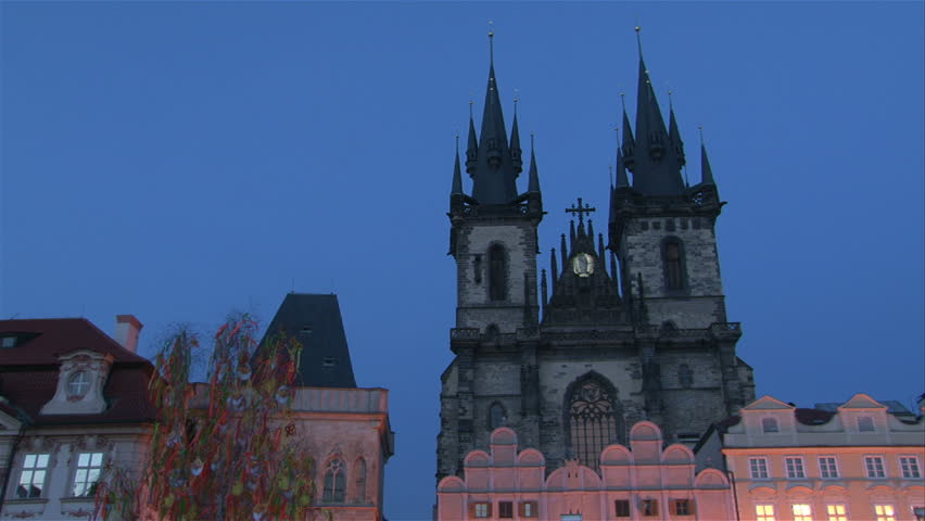 Lighting up of St. Teyn gothic cathedral on Old Town Square in Prague. Time lapse.