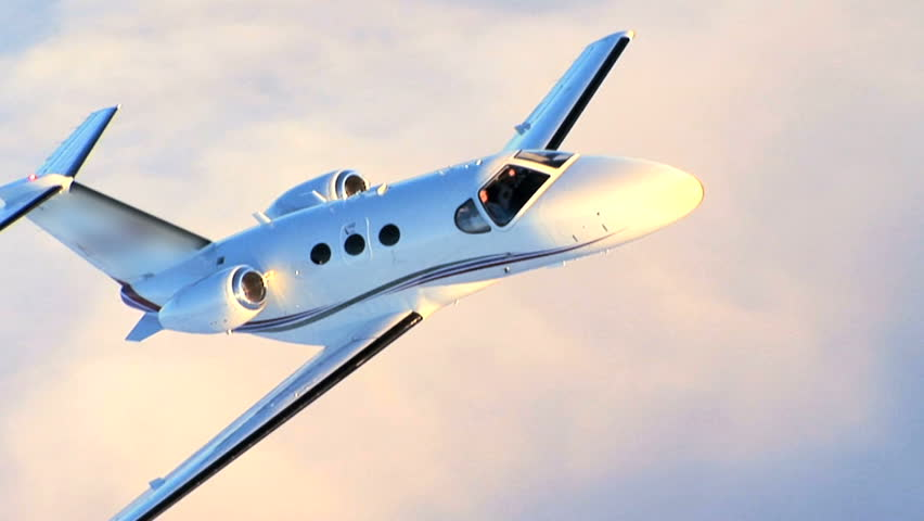 Air to air luxury corporate jet being used for modern business travel