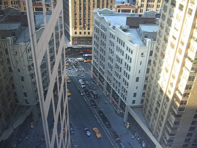 Manhattan building, taxis from above | Shutterstock HD Video #72697