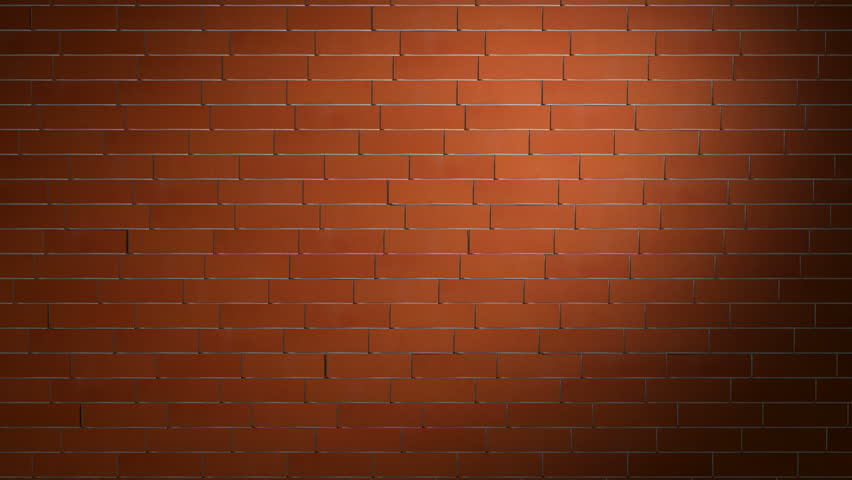 Crashing red brick wall revealing green background behind