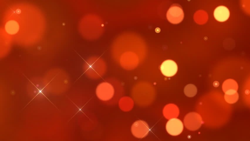 Seamlessly looping animation of defocused flowing light dots on red background