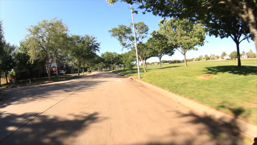 front view of a residential street while driving