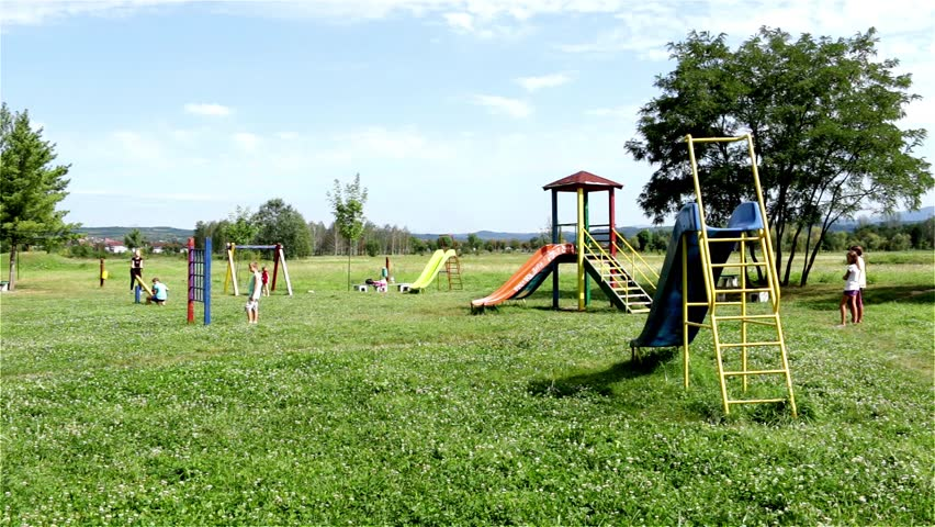 Young Girls Going Down On The Slide Playing Seesaw And Swinging A Swing Boy Sitting Metal Structure Kids Game Playground