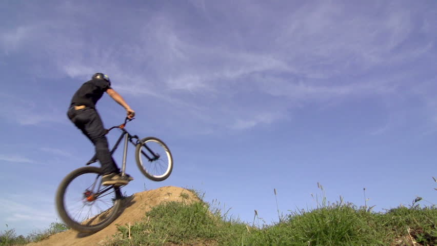 Slow Motion Of Skillful BMX Rider Performing Moto Whip Trick On Dirt Jump #7404817