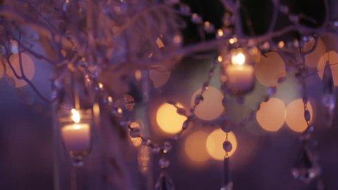 Decorative centerpiece at a wedding reception. Soft focus close up 1080p HD.