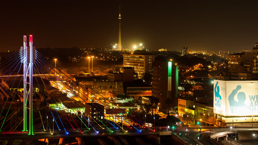 Johannesburg, Gauteng, South Africa - 25/07/2013      A colourful display of nighttime traffic between buildings in the mid city centre of Johannesburg.