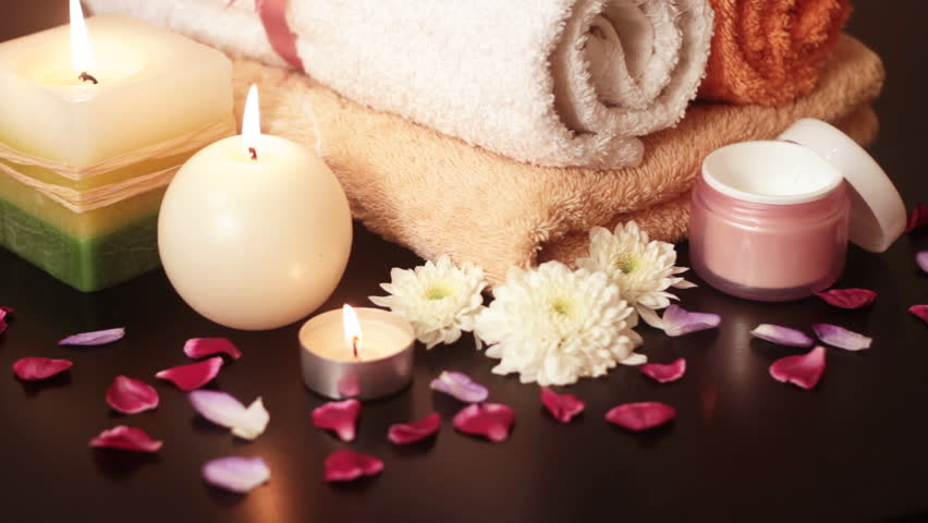 Spa accessories (moisturizer, candles, towels) at therapy center