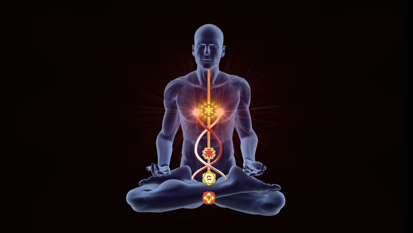 Man silhouette in enlightened yoga meditation pose with chackras symbols appearing in centers on the body