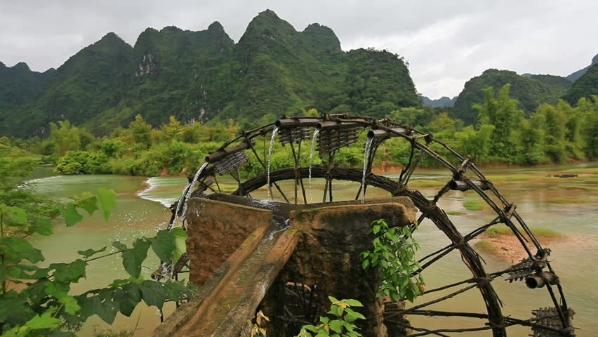 Bamboo water wheel. The use of water power for irrigation. Vietnam - Shutterstock