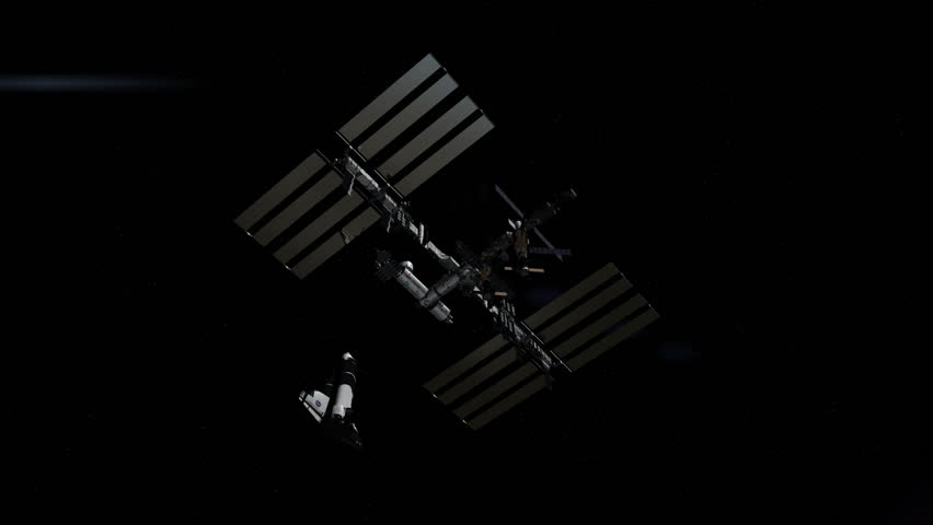 This CG animation depicts the International Space Station (ISS) fly through over the Earth with the a docking Space Shuttle.