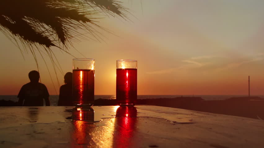 A couple drinking cocktails by the sea at the sunset: summer, love, holiday | Shutterstock HD Video #7523062