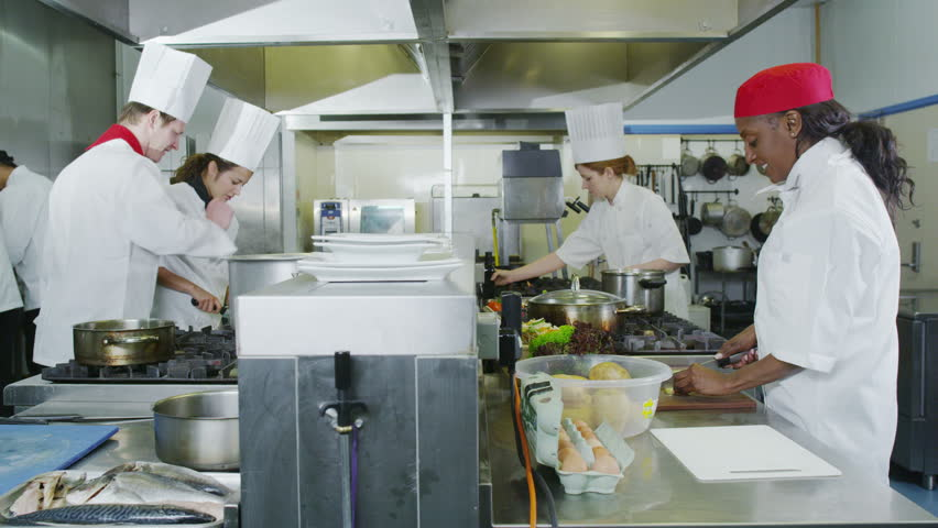 4K Team Of Professional Chefs Preparing Food In A Commercial Kitchen   4K  Stock Footage Clip