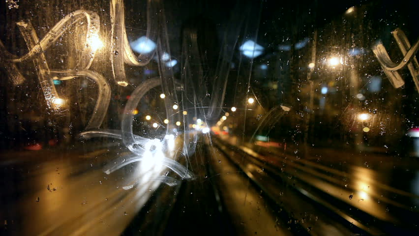 Tram's rear window view. Tram passes through tunnel. Cold rainy weather cityscape. Steamy window. Night time. Focus on window.  | Shutterstock HD Video #756313