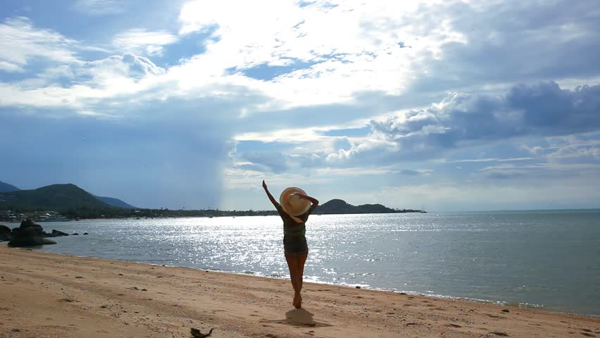 Young beautiful and fit woman walking in hat on a summer beach Koh Samui. HD, 1920x1080 | Shutterstock HD Video #7596337