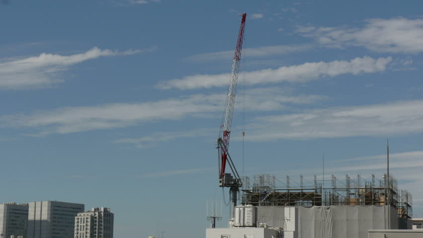 4K time lapse of cloud action over a construction site. | Shutterstock HD Video #7603087