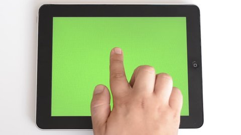 Slide on the tablet with green screen