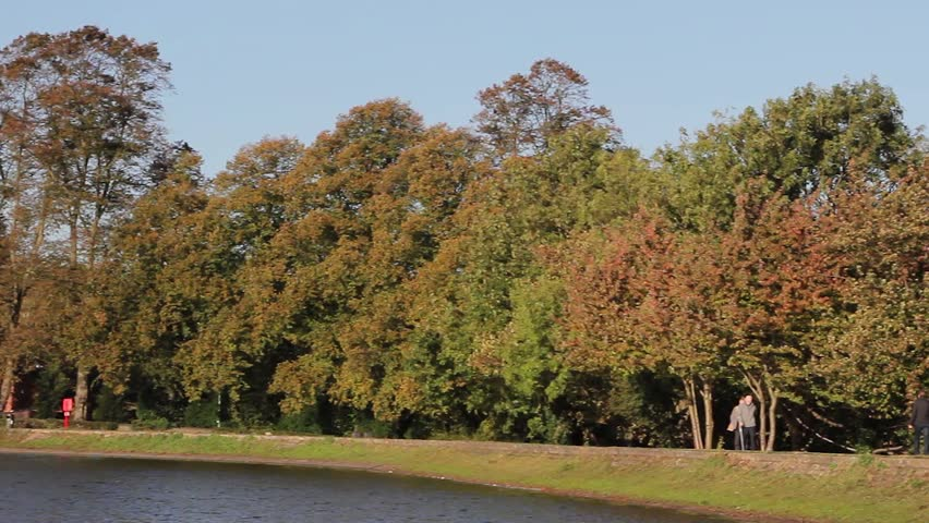 Beautiful Pan Autumn Leaves Trees toLichfield Catheral Over Stowe Pool Ducks Beautiful Morning Light Blue Sky - October, 2014  Location: Lichfield, Staffordshire, England, UK  Source: Canon 5DMkiii