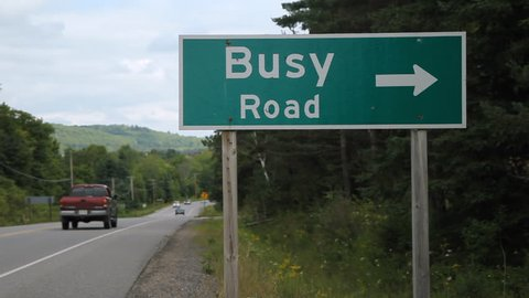 Busy Road. Road sign in Ontario, Canada. Busy Road. Traffic going by. Muskoka County, Ontario, Canada.