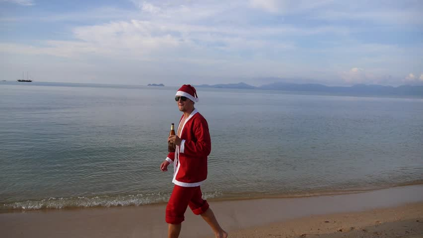 Happy Santa Claus Walking On Beach With Beer Merry Christmas And Happy New Year On Summer Vacation On Tropical Island Thailand Slow Motion