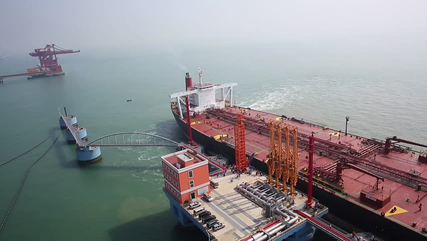 """Qingdao - October 8, 2014: carrying 136,000 tons of crude oil, """"the new Nika"""" round Dongjiakou port of Qingdao Port berthing 300,000-ton crude oil terminal, which is the first in the dock to dock cargo ships."""