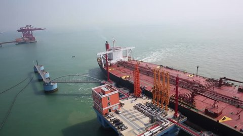 "Qingdao - October 8, 2014: carrying 136,000 tons of crude oil, ""the new Nika"" round Dongjiakou port of Qingdao Port berthing 300,000-ton crude oil terminal, which is the first in the dock to dock cargo ships."
