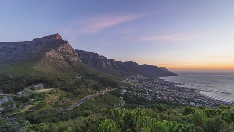 4K Timelapse 4096x2304 UHD of Cape Town Table Mountain at sunset, from day to night as the sun sets over the ocean. Holy grail timelapse shot in Cape Town South Africa