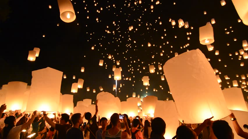 CHIANG MAI, THAILAND - OCTOBER 25 : Unidentified people release floating lamp in Tudongkasatarn on October 25, 2014, CHIANG MAI, THAILAND. Is place which floating lamp ceremony take place every year.