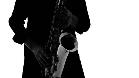 Dark silhouette of musician enthusiastically playing saxophone on a white background