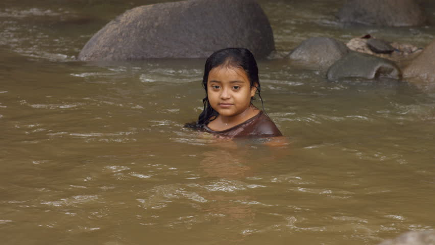 Young Girl In The Water With Naked Shoulders Stock Photo